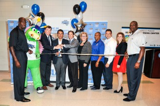 : The Orlando Magic cut the ribbon on the 11th Reading and Learning Center Presented by Kia Motors on April 23 at Rosemont Community Center. Pictured left to right: Magic Community Ambassador Bo Outlaw, STUFF the Magic Mascot, City Commissioner Robert Stuart, Magic CEO Alex Martins, Kia Motors District Sales Manager Justin Young, Magic VP of Community Relations Linda Landman Gonzalez, Rosemont Community Center Manager Brenda Scott, Turner Construction Special Projects Manager Bryan Burless, City of Orlando's Director of Family, Parks & Recreation Lisa Early, Magic Community Ambassador Nick Anderson. Photo taken by Fernando Medina.