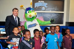 City Commissioner Robert Stuart, with STUFF the Magic Mascot and youth at the Rosemont Community Center during the Magic's unveiling of its 11th Reading and Learning Center presented by Kia Motors on April 23. Photo taken by Fernando Medina.