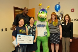 Seminole High School student Dana Liang, Magic Community Ambassador Bo Outlaw, Meizhen Mai (Liang's mother), STUFF the Magic Mascot, Orlando Magic Youth Foundation Administrator Stephanie Allen, Seminole State College Foundation Scholars Program Success Coach Tanya Fritz. Liang was surprised in her school by Magic representatives with news of her $6,000 Seminole State OMYF Scholarship on May 1. Photo taken by Gary Bassing.