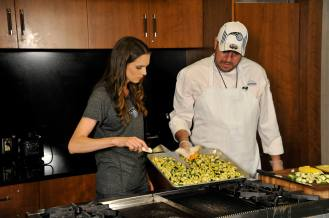 Magic Team Nutritionist Tara Gidus prepares dishes featuring local food with Amway Center Chef Leno Tena for the Summer Cooking Series presented by Fresh for Florida Kids. The series will be featured on the Magic's website, orlandomagic.com starting late June. Photo taken by Gary Bassing.