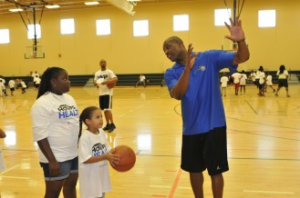 Orlando Magic Community Ambassador Nick Anderson helps youth with a skills clinic this summer during the Magic's Hoops for Health Challenge presented by UnitedHealthcare. Throughout the year, the Magic and UHC have partnered to engage local youth in approximately 40,000 hours of healthy, physical activity.