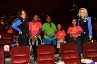 Magic Dancers meet youth from the Altamonte Boys & Girls Club and the Rosemont Community Center as they prepare for the private screening of Cloudy with a Chance of Meatballs 2 on Wednesday, September 25. The dancers joined Magic players Maurice Harkless and Tobias Harris at the movie screening. Photo taken by Gary Bassing.