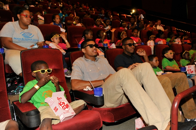 Magic players Tobias Harris (left) and Maurice Harkless (right) sit with youth from the Altamonte Boys & Girls Club and the Rosemont Community Center as they prepare for the private screening of Cloudy with a Chance of Meatballs 2 on Wednesday, September 25. Photos taken by Gary Bassing.