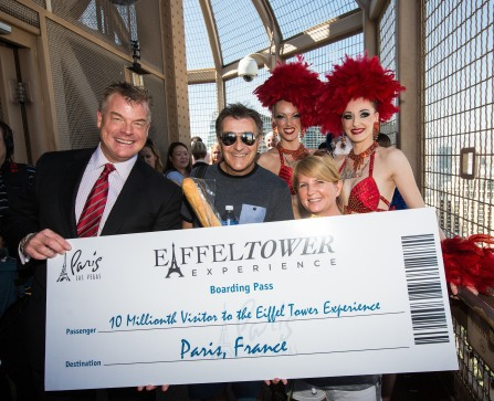 """Paris Las Vegas Regional President David Hoenemeyer and Jubilee! showgirls award the Eiffel Tower Experience 10 Millionth Visitor Martin Layton and his fiance Sarah Connell with a trip for two to Paris, France."" Image available"