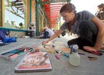 Chalk artist Lori Hughes, from Galloway, Ohio, sketches vibrant colors into her artwork Nov. 9, 2012 during Festival of the Masters at Downtown Disney. Festival of the Masters presented by Michaels features artistic creations from more than 130 award-winning artists, more than 20 up-and-coming Emerging Masters, the Disney Artist Village, live performance artists and more. The annual event takes place at Downtown Disney at Walt Disney World Resort in Lake Buena Vista, Fla. Nov. 8-10, 2013 and there is no charge for admission. (Kent Phillips, photographer) - See more at: http://wdwnews.com/galleries/2012/10/22/festival-of-the-masters/#photo-2