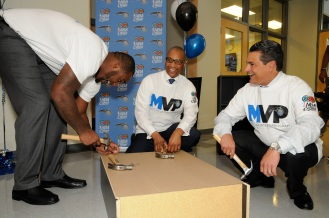 Magic player Glen Davis (left), Magic CEO Alex Martins (right) and Florida Blue Market President Central Florida Region Tony Jenkins (center) at the Magic's unveiling of one of the 25 reading corners that were built in one day on October 10. Magic staff members through the Magic Volunteer Program (MVP) and Florida Blue employees assisted in the building of the 25 corners. Photo taken by Gary Bassing.