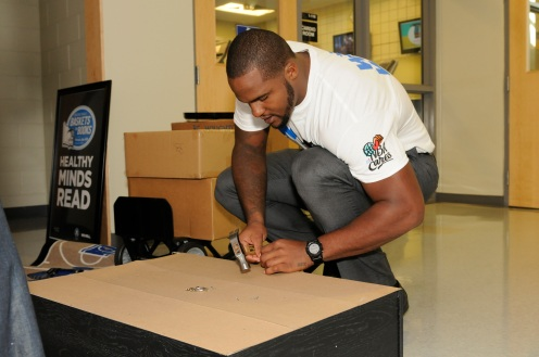 Magic player Glen Davis assiting with the reading corner build as part of the Magic's 25 reading corners built in one day. Magic staff members through the Magic Volunteer Program (MVP) and Florida Blue employees assisted in the building of the 25 corners. Photo taken by Gary Bassing.