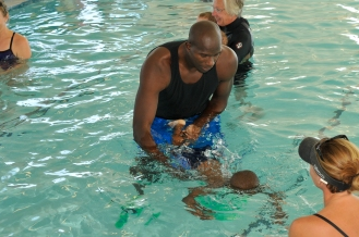 Magic Community Ambassador Bo Outlaw joins Magic guard Jameer Nelson as an assistant swim instructors at The Gift of Swimming after Nelson presented a check for $25,000 the organization. Photo taken by Gary Bassing.