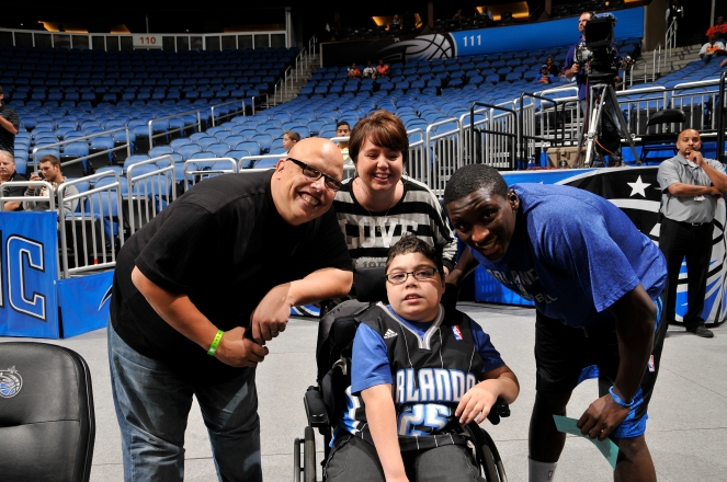 "Orlando Magic's Victor Oladipo poses with ten-year-old Caleb Dominguez prior to the Magic's Oct. 25 matchup against the New Orleans Pelicans. Dominguez was named the team's first ""Magic Maker"" and brought to a game for a VIP experience. Photo taken by Gary Bassing."