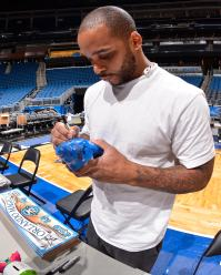 Orlando Magic guard Jameer Nelson signs items during the internal team autograph session on Nov. 15. All autographed items will be distributed back into the Central Florida community. Photo taken by Fernando Medina.