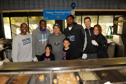 (left to right) Orlando Magic Head Coach Jacque Vaughn, Magic player Victor Oladipo, Magic CEO Alex Martins, Martins' daughters (front), Magic player Jason Maxiell, Magic GM Rob Hennigan and his wife Marissa all spent time serving food and visiting with residents at the Coalition for the Homeless on Thanksgiving morning.  Photo taken by Gary Bassing.