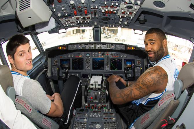 Orlando Magic players Nikola Vucevic (left) and Kyle O'Quinn (right) sit in the cockpit of a Southwest Airlines aircraft as part of the trading places event with Southwest Airlines all-star employees on Nov. 19. The players visited with passengers, signed autographs, took photos, sat in the cockpit and took boarding passes as part of the event. Photo taken by Fernando Medina.