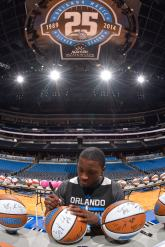 Orlando Magic guard Victor Oladipo signs approximately 300 basketballs during the internal team autograph session on Nov. 15. All autographed items will be distributed back into the Central Florida community. Photo taken by Fernando Medina.