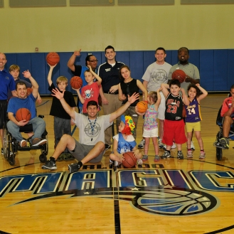 "On Sunday, March 2 at a local Orlando Magic recreation center, volunteers from Basketball Assist, a nonprofit organization based in Ohio that helps make the game accessible for youth with socioeconomic, physical or cognitive challenges, partnered with the Magic to conduct an ""Everyone Wins"" clinic for kids with special needs. Photo taken by Gary Bassing."
