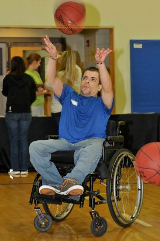 """On Sunday, March 2 at a local Orlando Magic recreation center, volunteers from Basketball Assist, a nonprofit organization based in Ohio that helps make the game accessible for youth with socioeconomic, physical or cognitive challenges, partnered with the Magic to conduct an """"Everyone Wins"""" clinic for kids with special needs. Photo taken by Gary Bassing."""