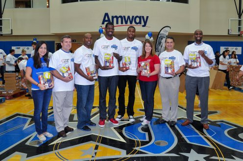 Pictured left to right: Development Manager at Second Harvest Food Bank Sasha Hausman, UnitedHealthcare Director of Account Management Todd Guiley, Magic Head Coach Jacque Vaughn, Magic player Andrew Nicholson, Magic player Maurice Harkless, UHC Director of Social Responsibility Shannon Lecher, Magic CEO Alex Martins , UHC Account Executive Alex Good. The group joined 300+ Magic staffers and UHC employees to assemble 13,500 food packs. The packs will be donated to the Second Harvest Food Bank of Central Florida as part of their Hi-Five Kids Packs Program. Photo taken by Fernando Medina.