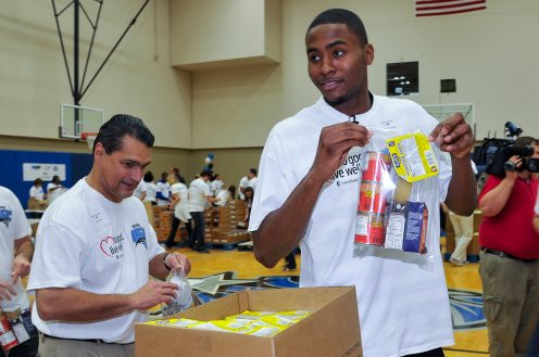 Magic CEO Alex Martins joined 300+ Magic staffers and UnitedHealthcare employees to assemble 13,500 food packs as part of the Magic and UHC's efforts to fight childhood hunger in Central Florida. The packs will be donated to the Second Harvest Food Bank of Central Florida as part of their Hi-Five Kids Packs Program. Photo taken by Fernando Medina. .
