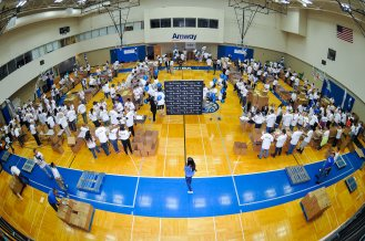 More than 300 Magic staffers and UnitedHealthcare employees joined forces to assemble 13,500 food packs as part of the Magic and UHC's efforts to fight childhood hunger in Central Florida. The packs will be donated to the Second Harvest Food Bank of Central Florida as part of their Hi-Five Kids Packs Program. Photo taken by Fernando Medina.