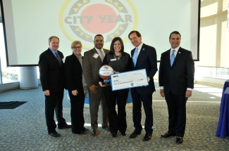 (left to right) Robert R. McCormick Foundation Communities Program Director Bill Koll; Magic Vice President of Philanthropy and Multicultural Insights Linda Landman Gonzalez; City Year Orlando Board Member Joe Terry; City Year Orlando VP and Executive Director Jordan Plante; Magic Chairman Dan DeVos; Magic CEO Alex Martins at the 2014 Orlando Magic Youth Fund All-Star grant ceremony in January. The OMYF-MFF distributed grants totaling $600k to 25 nonprofit organizations in Central Florida. Photo taken by Gary Bassing.