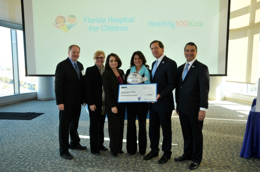 (left to right) Robert R. McCormick Foundation Communities Program Director Bill Koll; Magic Vice President of Philanthropy and Multicultural Insights Linda Landman Gonzalez; Florida Hospital Foundation Senior Grants Officer Linda Moffa; Florida Hospital for Children Medical Director for Healthy 100 Kids Dr. Angela M. Fals; Magic Chairman Dan DeVos; Magic CEO Alex Martins at the 2014 Orlando Magic Youth Fund All-Star Grant Ceremony in January. The OMYF-MFF distributed grants totaling $600k to 25 nonprofit organizations in Central Florida including $30,000 to Florida Hospital for Children's Healthy 100 Kids Program. Photo taken by Gary Bassing.