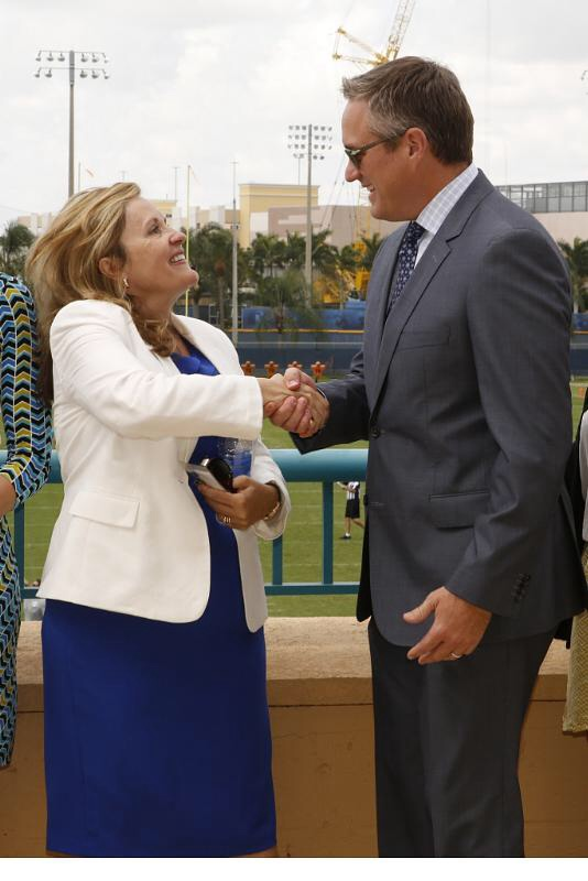 caption:	AARP President Lisa Marsh Ryerson and Dolphins President & CEO Tom Garfinkel. (PRNewsFoto/AARP Foundation)