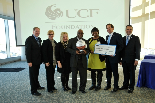 (left to right) Robert R. McCormick Foundation Communities Program Director Bill Koll; Magic Vice President of Philanthropy and Multicultural Insights Linda Landman Gonzalez; UCF Foundation Assistant Vice President Kara Fleharty Schultz; UCF Director of Multicultural Academic and Support Services Wayne Jackson; UCF Assistant Vice President of Student Development and Enrollment Services Belinda Boston; Magic Chairman Dan DeVos; Magic CEO Alex Martins at the 2014 Orlando Magic Youth Fund All-Star grant ceremony in January. The OMYF-MFF distributed grants totaling $600k to 25 nonprofit organizations in Central Florida including $35,000 to the University of Central Florida Foundation. Photo taken by Gary Bassing.