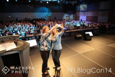 Mayor Teresa Jacobs and FlBlogCon Founder Bess Auer take an #ussie with the room of  conference participants at Full Sail University.