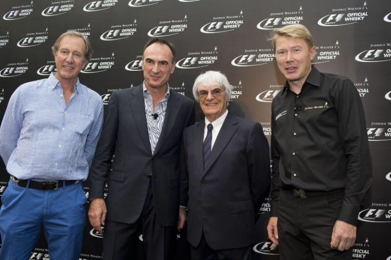 caption:	Pictured at the announcement of Johnnie Walker® as the Official Whisky of FORMULA 1 were Dr Nick Blazquez, President, Diageo Africa and Asia (second from left), with Bernie Ecclestone, Chief Executive Officer of the Formula One group, flanked by Mika Häkkinen (right), Johnnie Walker Global Responsible Drinking Ambassador, and Robbie Walker (left), a direct descendant of the brand's founder, John Walker.
