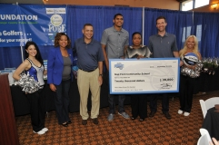 Pictured left to right: Magic Dancer Jamie; Magic Assistant Director of Community Relations Latria Leak; Magic VP/Asst. GM Scott Perry; Magic Forward Tobias Harris, Nap Ford Community School Executive Director Jennifer Porter-Smith; Magic GM Rob Hennigan; Magic Dancer Nicole. On Friday, September 12, Harris presented Nap Ford Community School a check for $20,000 as part of the $50k he distributed to Orange County Public Schools as a result of the Rich and Helen DeVos Community Enrichment Award. Photo taken by Gary Bassing.