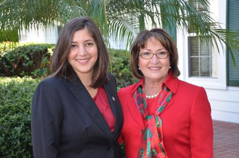 Mayor Teresa Jacobs and her Chief of Staff Graciela Noriega Jacoby are pictured at a 2013 holiday gathering at Cypress Grove Estate House on Lake Jessamine.
