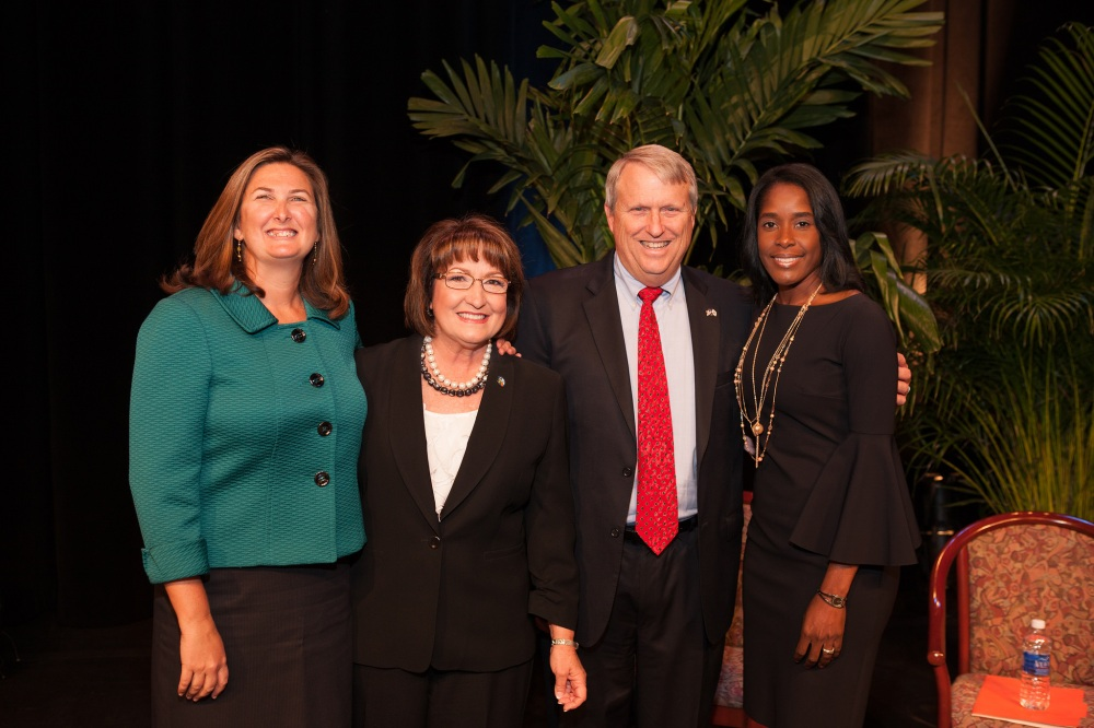 From left: Orange County District 4 Commissioner Jennifer Thompson, Mayor Teresa Jacobs, District 2 Commissioner Bryan Nelson and District 6 Commissioner Victoria P. Siplin take the Oath of Office at the Linda W. Chapin Theater at the Orange County Convention Center.