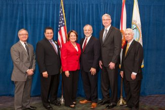 (Left  to right) Manuel Mencia, senior vice president of international trade and business development with Enterprise Florida; Ken Potrock Senior Vice President and General Manager of Disney Vacation Club & Adventures by Disney; Orange County Mayor Teresa Jacobs; Rick Weddle, the CEO of the Orlando Economic Development Commission; Economist Sean Snaith, Ph.D., director of the University of Central Florida's Institute for Economic Competitiveness; and James Bacchus, global practice chair of the Greenberg Traurig law firm.