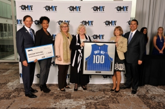 On Feb. 5, the Orlando Magic Youth Fund, a McCormick Foundation Fund, distributed $100k to Osceola Council on Aging, one of two organizations to receive $100k. Pictured left to right: Magic Chairman Dan DeVos, Robert R. McCormick Foundation representative Lesley Kennedy, Magic VP of Philanthropy and Multicultural Insights/OMYF President Linda Landman Gonzalez, Osceola Council on Aging CEO Beverly Hougland, Osceola Council on Aging CFO Connie Benca and Magic CEO Alex Martins. Representatives from 21 nonprofit organizations in Central Florida were named to the OMYF All-Star Team, receiving grants totaling $1 million from the OMYF-MFF. Photo taken by Gary Bassing.