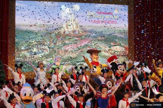 Dancers perform during the groundbreaking ceremony of Shanghai Disneyland in Pudong April 8, 2011. REUTERS/Aly Song