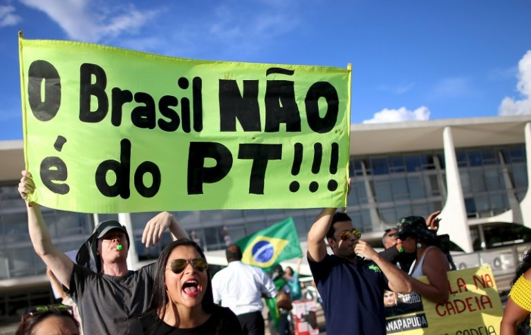 Anti-government demonstrators shout slogans against Brazil's President Dilma Rousseff during a protest in Brasilia