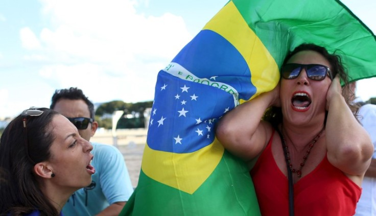 An anti-government demonstrator shouts slogans against a supporter of Brazil's President Dilma Rousseff during a protest in Brasilia