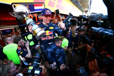 MONTMELO, SPAIN - MAY 15: Max Verstappen of Netherlands and Red Bull Racing celebrates with the team in the pit lane after winning his first F1 race at the Spanish Formula One Grand Prix at Circuit de Catalunya on May 15, 2016 in Montmelo, Spain. (Photo by Dan Istitene/Getty Images)
