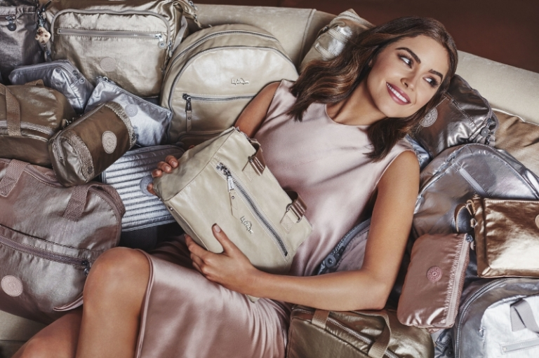 Kipling USA Holiday Campaign with Olivia Culpo